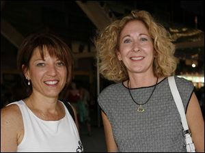 Elizabeth Kollar, left, and Sandra Hylant are just two Chicks for Charity at the fund-raiser for Assistance Dogs of America.