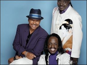 Earth, Wind & Fire, featuring, clockwise from bottom, Verdine