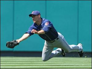 Grady Sizemore makes a diving catch in the seventh inning of yesterday afternoon's game against the Angels. Sizemore contributed his 25th home run to the Tribe's 14-hit attack.