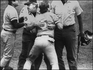 Umpire Joe Brinkman keeps George Brett from going after umpire Tim McClelland, who denied Brett s home run.