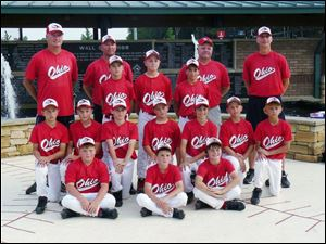 The 11U Ohio Diamond Hawks: back row, from left, coaches Ron Rightnowar, Greg Buescher, Craig Stambaugh, and Kevin Johnson. Players standing: TJ Lake, Jared Rettig, and Louie Mauro. Kneeling: Colin Kaucher, Tyler Stambaugh, Noah Best, Connor Bowen, Luke Rightnowar, Josh Kruzel, and Casey Johnson. Sitting: Danny Kruzel, Camden Buescher, and Trevor Hafner.