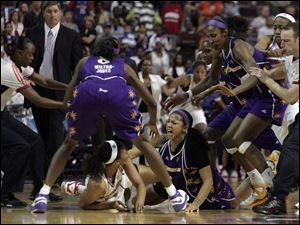 The Shock's Plenette Pierson, on floor at left, scuffles with the Sparks' Candace Parker, both of whom wer