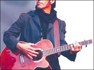 Nils Lofgren, guitarist for the E Street Band.