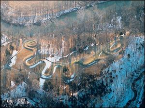 Serpent Mound in Adams County, the world s largest effigy mound, is strikingly highlighted by a low winter sun.