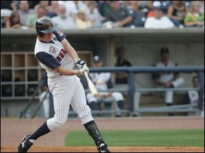 Mike Hessman hits a two-run home run in the second inning. It was his final game with the Mud Hens before leaving to join the U.S. Olympic team along with teammate Blaine Neal.