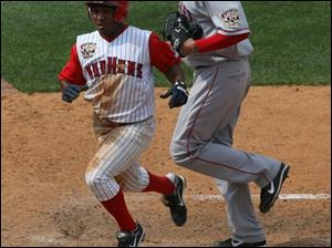 Freddy Guzman scores the winning run in the 12th inning when Pawtucket pitcher Lincoln Holdzkom threw a wild pitch for strike three.