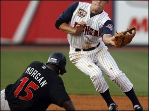 The Mud Hens  Michael Holliman tries to make the tag as Indy s Nyjer Morgan steals second base during the fourth inning.