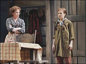 Melissa Gilbert, left, plays the matriarch of the Ingalls family in the Guthrie Theatre s production of Little House on