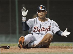 Detroit Tigers' Carlos Guillen celebrates after sliding home to score on Placido Polanco's ground out in the 13th inning early Thursday morning. The run broke a 12-12 tie and the Tigers went on to win 14-12.