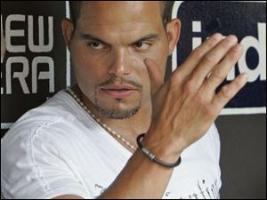 Ivan Rodriguez talks with reporters yesterday in Cleveland after finding out he'd been traded by the Tigers to the Yankees.
