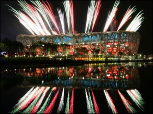 Fireworks light up the National Stadium at a rehearsal for Friday s upcoming opening ceremonies of the Beijing Olympics.