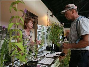 Jan Hunter, co-owner of Naturally Native Nursery in Bowling Green, talks with Bill Laudick of Holland about landscaping.