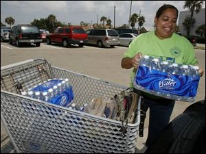 Sherran Thompson stocks up on bottled water in at a supermarket in Galveston, Texas on Monday in preparation for Tropical Storm Edouard.