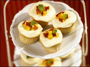 Mini Vanilla-Almond Peach Cupcakes with Fresh Peach Frosting.