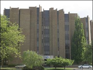 The oddly shaped downtown structure that has housed the United Way and and its forerunners and numerous nonprofit agencies since the 1960s will be torn down. (THE BLADE)