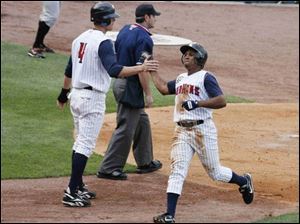 Kody Kirkland (4) greets Freddy Guzman after they had scored in the second inning.