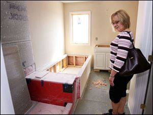 Carol Bintz checks out what will be her master bath. The geothermal system will also heat the energy-effi cient home s water.