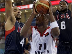 Angola's Felizardo Ambrosio, center, is double-teamed by 
