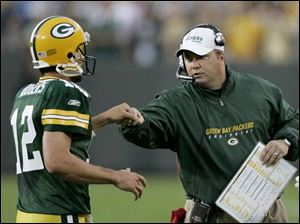 Packers' coach Mike McCarthy seems pleased with Aaron Rodgers' 9-of-15 passing for 117 yards against Cincinnati.