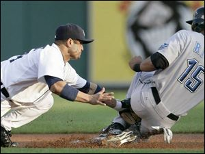 Toronto's Alex Rios, right, beats the tag from Detroit's Placido Polanco to steal second base.