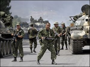 Russian soldiers block the road on the outskirts of Gori, northwest of the capital Tbilisi, Georgia, Thursday.