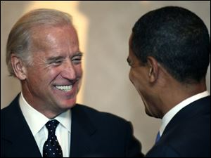 Presidential hopeful, Sen. Joseph Biden, D-Del., speaks with Sen. Barack Obama, D-Ill., at the Sisters on Target banquet in Des Moines, Iowa, in this Saturday, Oct. 13, 2007 file