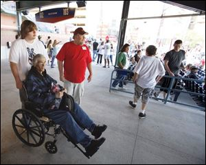 Nine months after receiving a grim prognosis, Randy Steele is alive and savoring each moment. He marked July 4 by taking in a Mud Hens game, where he got a push from his son, Jonathon.