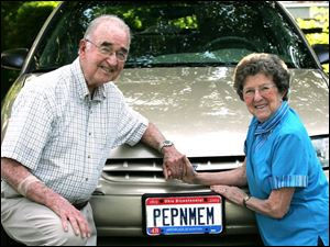 Bob and Alice LaFleche s license plate combines their nicknames,  Pep  and  Mem.
