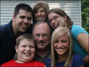 Jim Lefevre, center, is surrounded by his grandchildren, clockwise from bottom left: Troy Lefevre, Jared Lefevre, Caitlin