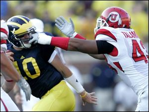 Utah s Lei Talamaivao gets a handful of facemask when trying