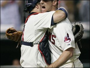 Cliff Lee gets a hug from his catcher, Kelly Shoppach, after the Indians' left-hander won his 20th game by shutting out the White Sox on five hits. He is now 20-2 on the season.