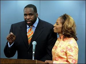 Detroit Mayor Kwame Kilpatrick standing with his wife Car