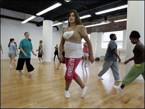 Christina Pietrzak, 12, of Toledo joins other students for dance class at the Toledo School for the Arts. Renovation of 22,000 square feet at the downtown building took nine weeks to complete and enabled the charter school to increase enrollment.