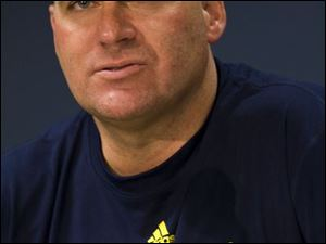 Rich Rodriguez is set to sign a contract to coach UM football 10 months after his hiring.
