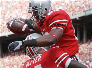 Ohio State wide receiver Ray Small (82) celebrates his touchdown with Nate Oliver (14) during the fourth quarter of an NCAA college football game against Ohio, Saturday, Sept. 6, 2008
