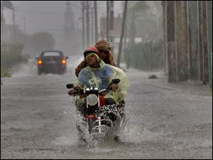 Residents make their way through a flooded street after Hurricane Ike hit the area in Camaguey, Cuba.