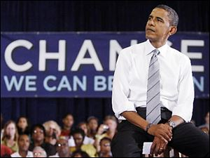 Democratic presidential candidate Sen. Barack Obama, D-Ill., waits to speak during a town hall meeting at North Farmington High School in Farmington Hills, Mich., Monday, Sept. 8, 2008.