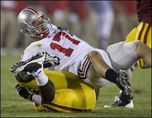 Ohio State quarterback Todd Boekman is sacked in the third quarter against Southern California in an NCAA college football game in Los Angeles, Calif., Saturday, Sept. 13, 2008.