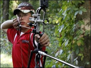 Ben Cleland, 15, of Swanton has become a champion archer and will be on the world junior team in Turkey this fall.