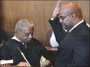 Detroit Mayor Ken Cockrel Jr., right, is sworn in by U.S. Appeals Court Judge Damon Keith on Friday.