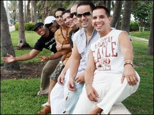 The members of Tiempo Libre, from front to back, are Jorge Gomez, Luis Beltran Castillo, Ra l Rodr guez Hernandez,