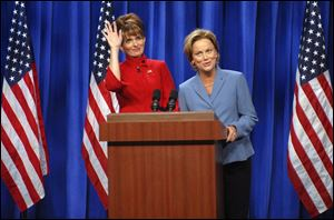 In this photo provided by NBC, actress Tina Fey, left, plays Governor Sarah Palin, and actress Amy Poehler plays Senator Hillary Clinton on <i>Saturday Night Live</i>  Sept. 13 in New York.