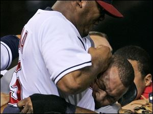 Indians hurler Fausto Carmona has Tigers outfielder Gary Sheffield in a headlock as the two go at it last night. The fireworks began after Carmona plunked Sheffield. He followed that up with a pickoff attempt. Sheffield jawed about it and charged the pitcher. Both benches then joined in.