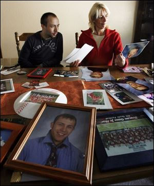 Jordan Laskey and his mother, Jodi, look over mementos.  To this day   I just think that this