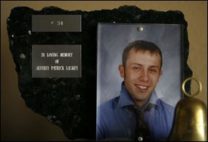 A plaque is dedicated to Jeffery Laskey, who hanged himself in a bathroom at Bowling Green High School.