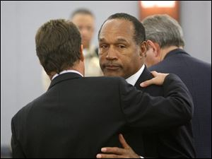 O.J. Simpson, right, with his lawyer Yale Galanter embrace after a verdict of guilty on all counts was read following his trial at the Clark County Regional Justice Center in Las Vegas on Friday, Oct. 3, 2008. The verdict comes 13 years to the day after Simpson was acquitted of murdering his ex-wife Nicole Brown Simpson and Ron Goldman.