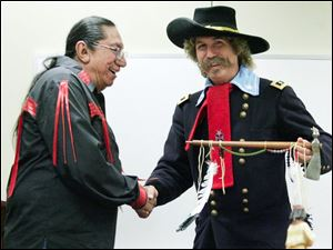 Ernie LaPointe, great-grandson of Sitting Bull, greets Steve Alexander, in the guise of Lt. Col. George Armstrong Custer, at the annual meeting of the Perrysburg Area Historic Museum.