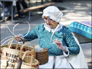 Slug: NBRE swamp09p                             Date: 10/05/2008             The Blade/Amy E. Voigt                     Location: Oregon, Ohio  CAPTION:  Maumee Bay Basket Weaver's Guild member Kathy Clark, from Oregon, weaves a basket during the Black Swamp Festival at Pearson Park, Packer-Hammersmith Center on October 5, 2008 in Oregon. The free event included crafts, artisan demonstrations and entertainment.