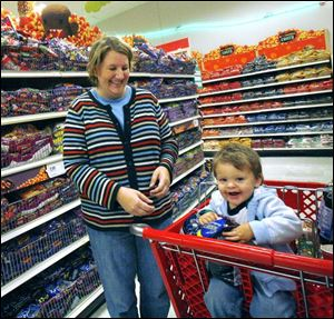 Jennifer Harold, of Lambertville, with son William, is stocking up for trick-or-treaters.