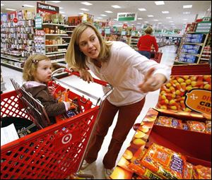 Meredith Hustwick, of Sylvania Township, said she doesn t plan to scrimp on Madeline, in the shopping cart.